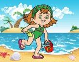 Petite fille avec plage seau et pelle