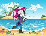 Fille avec le parapluie sous la pluie